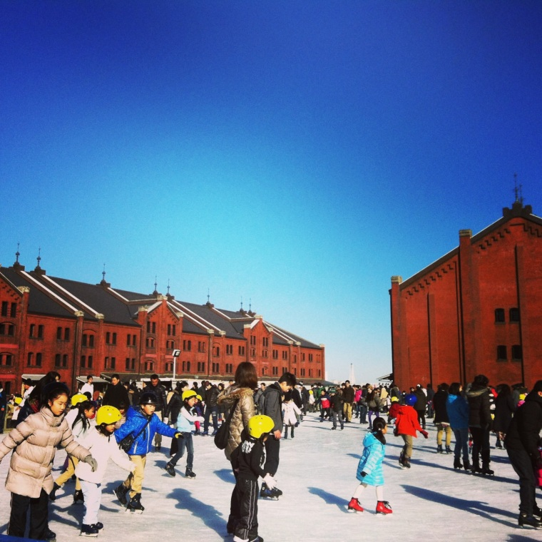 Skating rink by the red brick houses